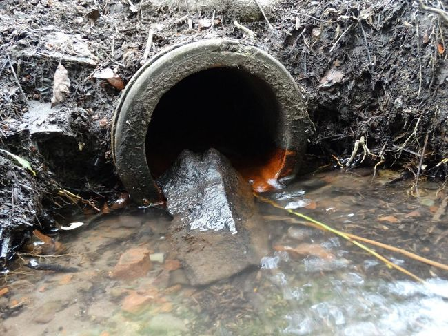 Drain pipe. Sewer Connection Pipe Drain Drainage Sewage Water Outdoors Nature Built Structure Gutter Under Close-up Pipes System Sewer System Drainage Pipes Stream Water Reflections Drain Pipe Drain Pipes Sewer Drain