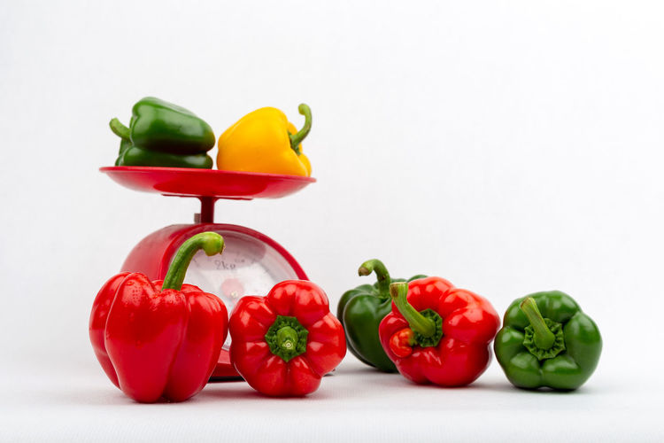 Close-up of bell peppers against white background