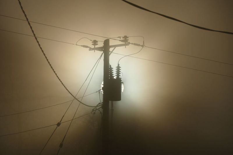 Foggy day.. Cable Connection Day Dream States Electric Pole Electricity  Electricity Pylon Ethereal Fog Foggy Foggy Weather Fuel And Power Generation Low Angle View No People Outdoors Power Line  Power Supply Silhouette Silhouette_collection Sky Softness Sunset Technology The Street Photographer - 2017 EyeEm Awards The Great Outdoors - 2017 EyeEm Awards Perspectives On Nature