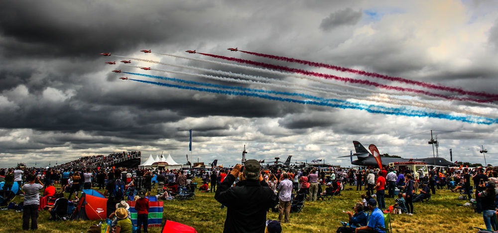 Aerobatics Air Vehicle Aircraft Airshow Cloud - Sky Crowd Fighter Plane International Air Tattoo Large Group Of People Military Airplane Multi Colored Performance Red Arrows Sky Vapor Trail