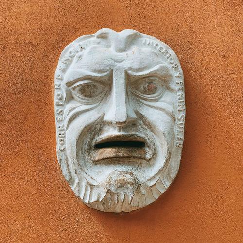 Close-up of gargoyle on wall