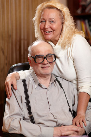 Portrait Of Happy Woman With Senior Man At Home