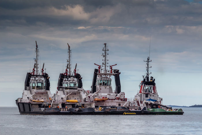 Firth of Forth Tug Boats Firth Firth Of Forth Scotland Cargo Container Cloud - Sky Commercial Dock Day Forth Freight Transportation Harbor Industry Mode Of Transport Nautical Vessel No People Offshore Platform Oil Industry Outdoors Sea Ship Shipping  Shipyard Sky Transportation Tug Boat Water