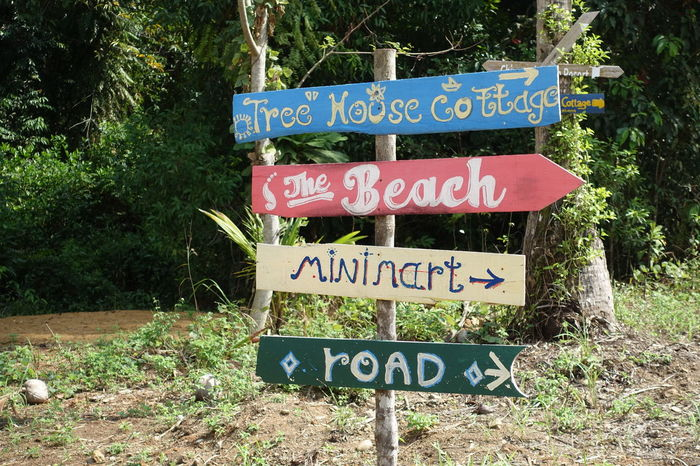 Signs Arrows Tree House Beach Minimart Road Ko Chang Island Thailand Holidays Traveling Travel Photography Nature Pastel Power Spotted In Thailand