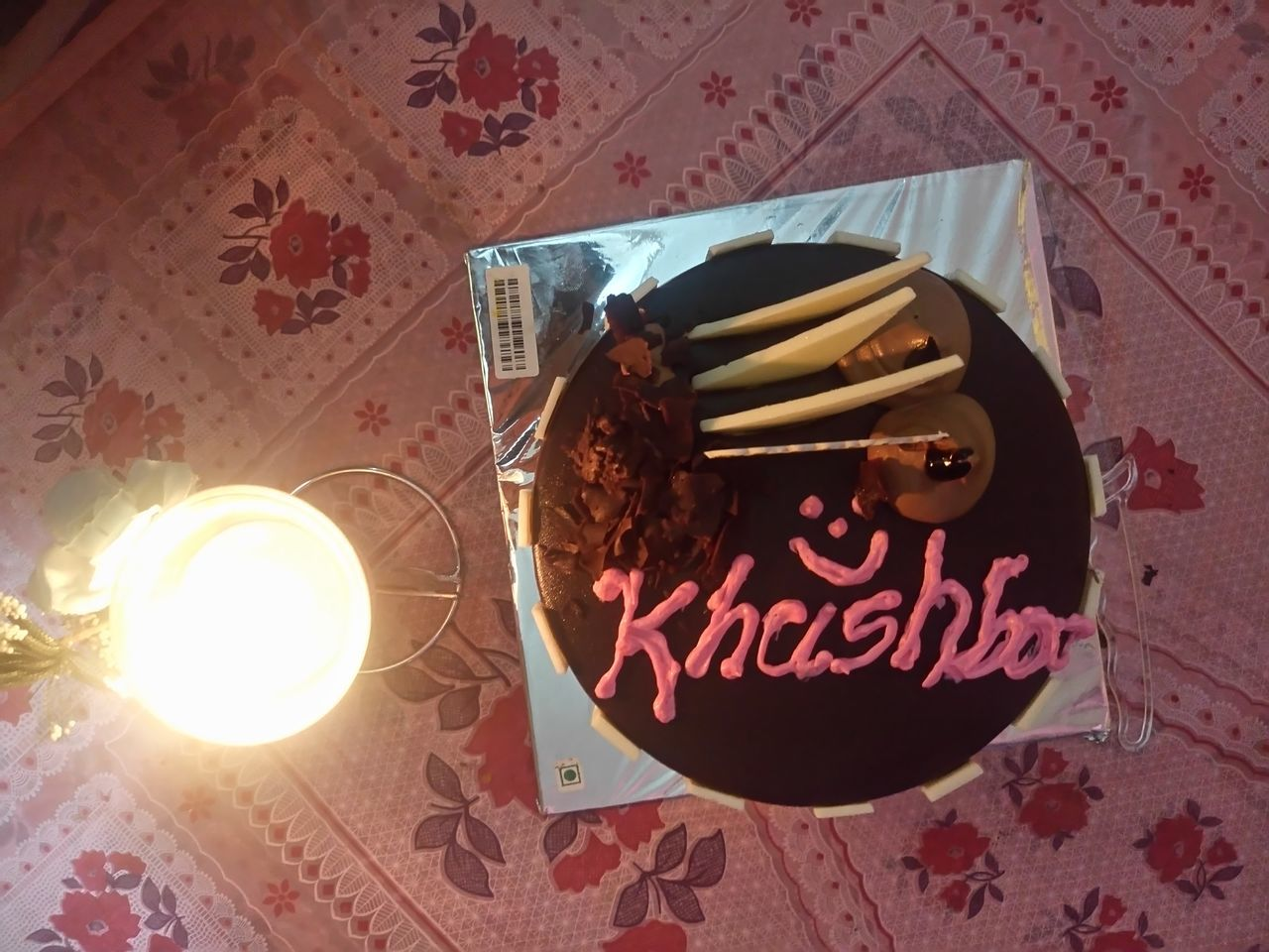 food and drink, indoors, table, text, sweet food, plate, food, cake, high angle view, no people, indulgence, freshness, tablecloth, celebration, birthday cake, temptation, close-up, drink, ready-to-eat, flower, day