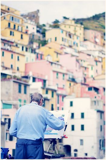 Justclick Kaushalgokarankar'sphotography Travel Destinations Cinque Terre Italy🇮🇹 Cityscape Outdoors Europe Trip Rear View City City Life Street People Architecture Adult One Person Adults Only One Man Only Lifestyles Only Men Building Exterior Men Day Young Adult