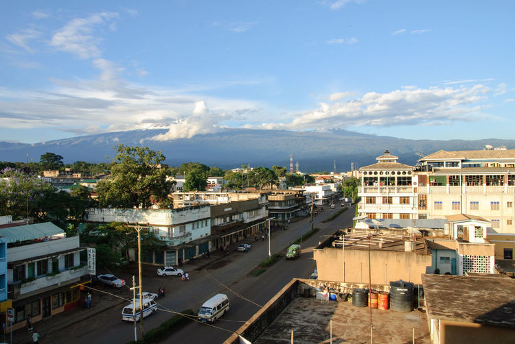 Kilimanjaro from Moshi TOWNSCAPE Tanzania Africa Architecture Built Structure City Cityscape Cloud - Sky Kilimanjaro Moshi Mountain Outdoors Road Sky Street Town Transportation