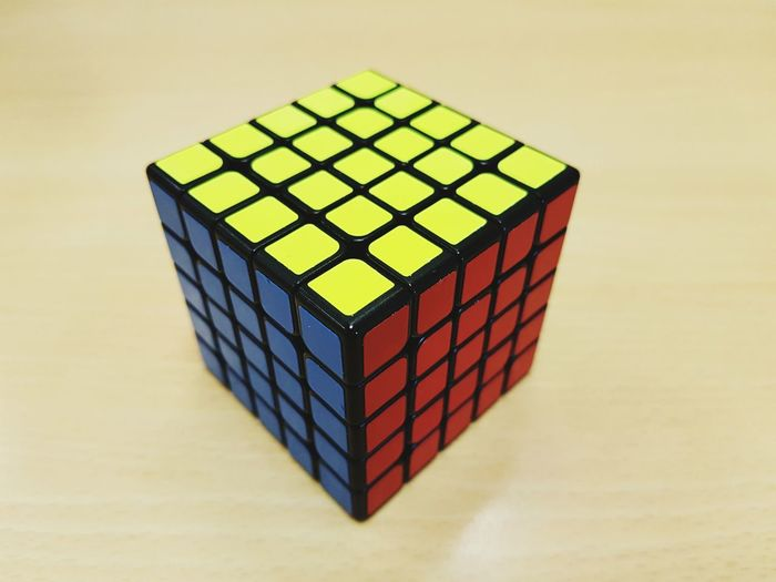 No People RISK Green Color Complexity Studio Shot Indoors  Close-up Day Ingot Business Finance And Industry Cubo Rubik Rubik's Cube Intelligence Negocio Strategy Game Indoors  Toy Block Gambling Multi Colored Leisure Games Puzzle  Stack Paint The Town Yellow