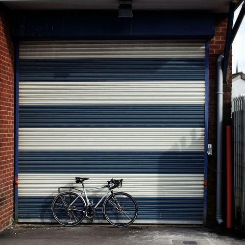 Bicycle leaning against garage door