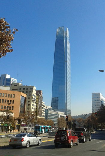 Architecture Blue Building Exterior City Cityscape Clear Sky Day Gran Torre Modern No People Outdoors Skyscraper Torre Tourism Travel Travel Destinations Tree