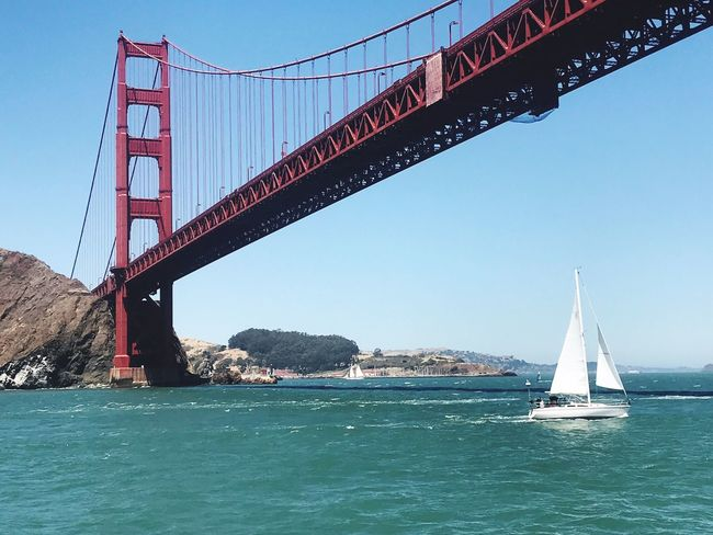 Sailing San Fransisco Bay Beneath Golden Gate Bridge . Bridge - Man Made Structure Transportation Engineering Water Bay Sea Mode Of Transport Suspension Bridge Clear Sky Built Structure Day Waterfront Architecture Sail Boat Sailboat Outdoors Sky Travel Destinations Nautical Vessel No People Been There.