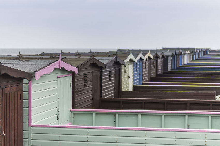Beach huts in Frinton-on-Sea, Essex, England, United Kingdom Architecture Beach Beach Huts British Building Exterior Built Structure Cabin Clear Sky Coast Coastal Colourful Day England Essex Frinton-on-Sea Huts Nature No People Outdoors Row Sea Seaside Shed Sky United Kingdom
