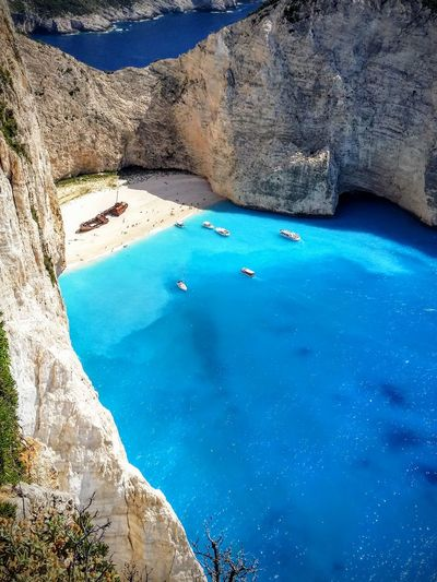 Shipwreck Cove Navagio Beach on the Greek island of Zakynthos Beach Beauty In Nature Blue Cliffs Greece Greek Islands Holidays Ionian Navagio Beach Sea Shipwreck Shipwreck Cove Summer Tourism Travel Travel Destinations Vacations Zakynthos Zante