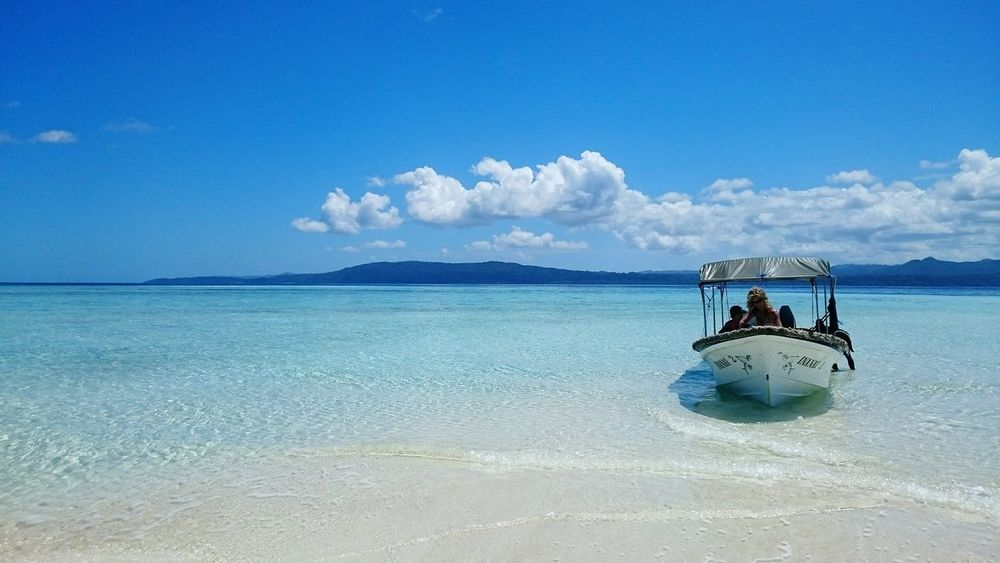 Sea Blue Water Nautical Vessel Sand Beach Outdoors Sky Vacations Nature Floating On Water Cloud - Sky One Person Adults Only People Adult Day INDONESIA Diving Papua EyeEm Masterclass Vacations EyeEm Best Shots Nature Beauty In Nature