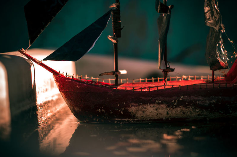 Tilt shift image of ship moored in water