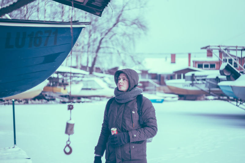 Young man standing in snow