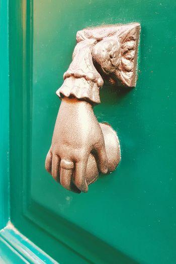 Close-up of dragon on metal door