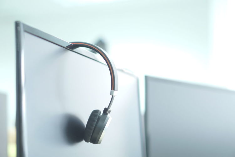Close-up of computer and headphones