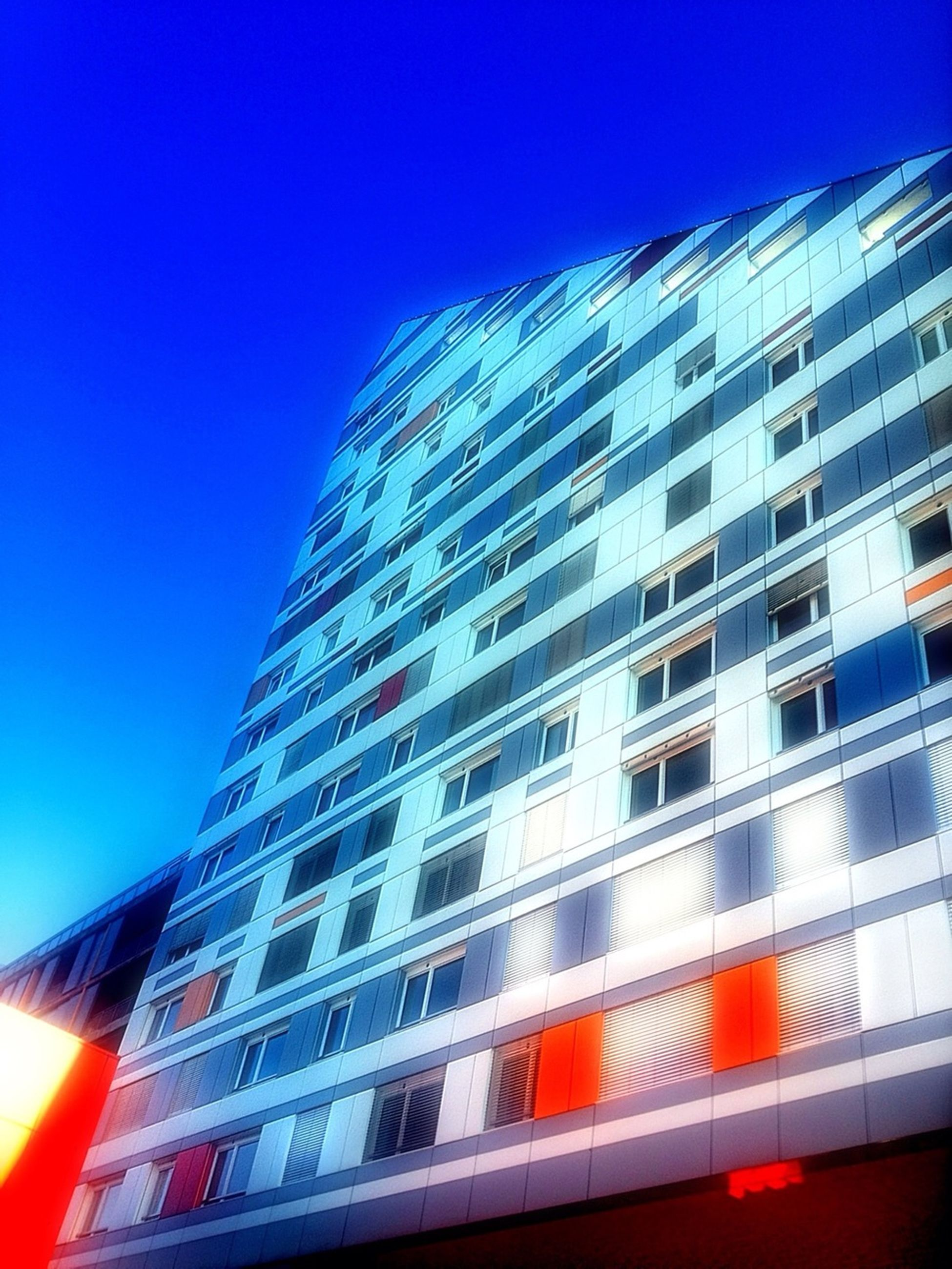 architecture, building exterior, built structure, modern, low angle view, city, office building, skyscraper, clear sky, tall - high, blue, building, glass - material, tower, reflection, window, city life, day, outdoors, no people