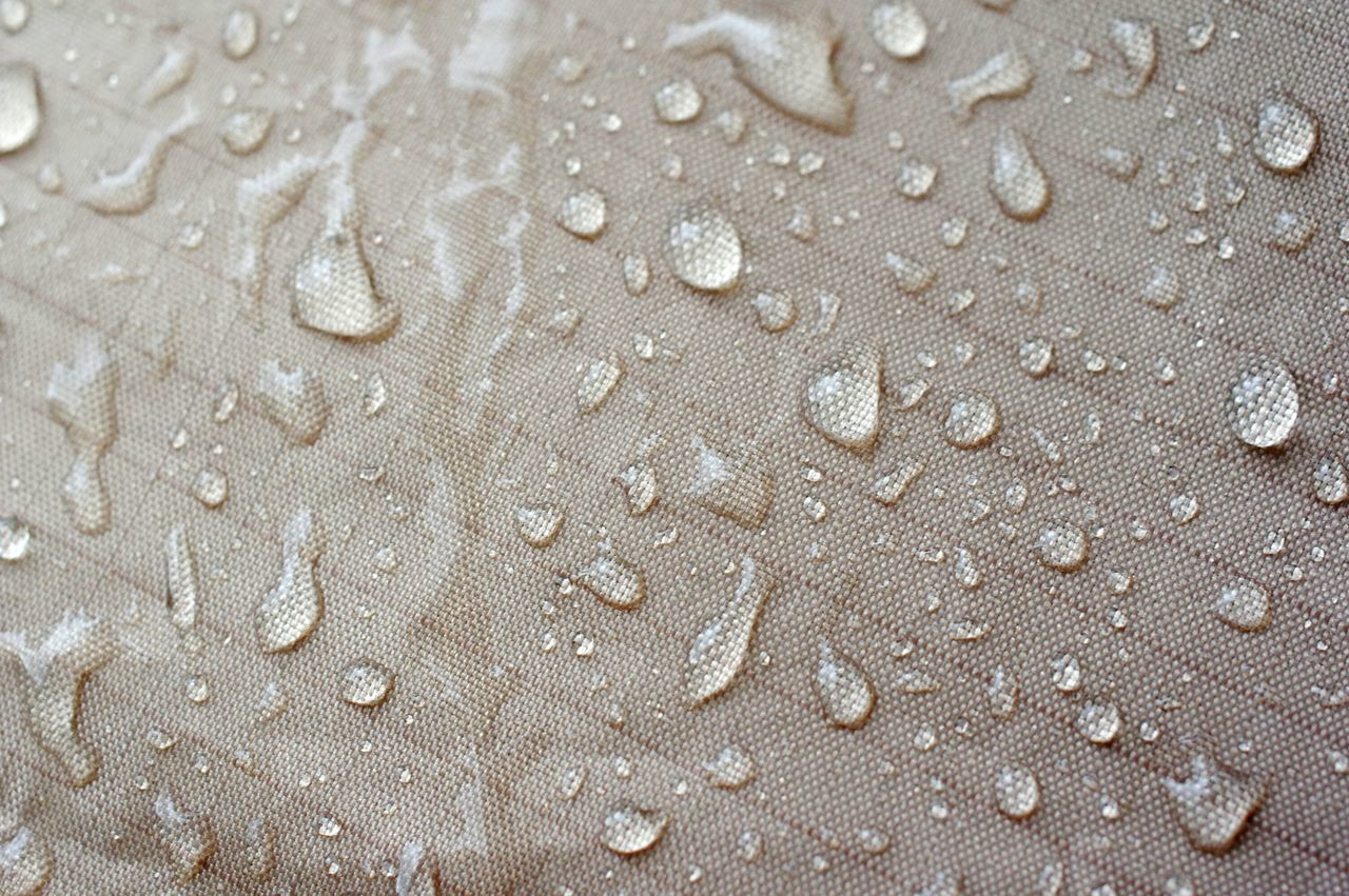 Full Frame Shot Of Water Drops On Fabric
