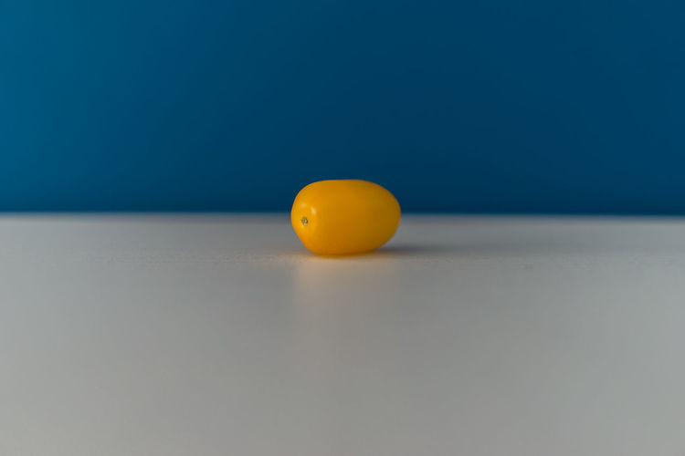 Close-up of yellow ball on table
