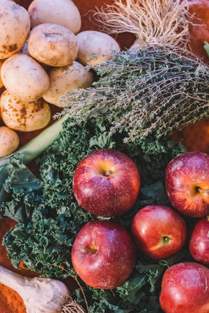 Bounty of fruit and vegetable from CSA share. Apple Csa Day Flatlay Food Food And Drink Freshness Garlic Green Health Healthy Healthy Eating High Angle View Kale Large Group Of Objects No People Potato Red Thyme Variation Vegan Vegetable Vegetarian