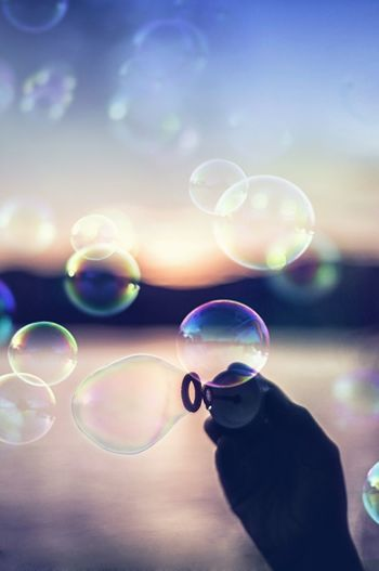 Bubble Rainbow Multi Colored Spectrum Bubble Wand Fragility Refraction Day Human Body Part Science Close-up Eyesight Nature Indoors  One Person One Man Only People Nature Floating In Water Smooth Water Sunlight Springtime Beauty In Nature Outdoors Fresh On Market 2017