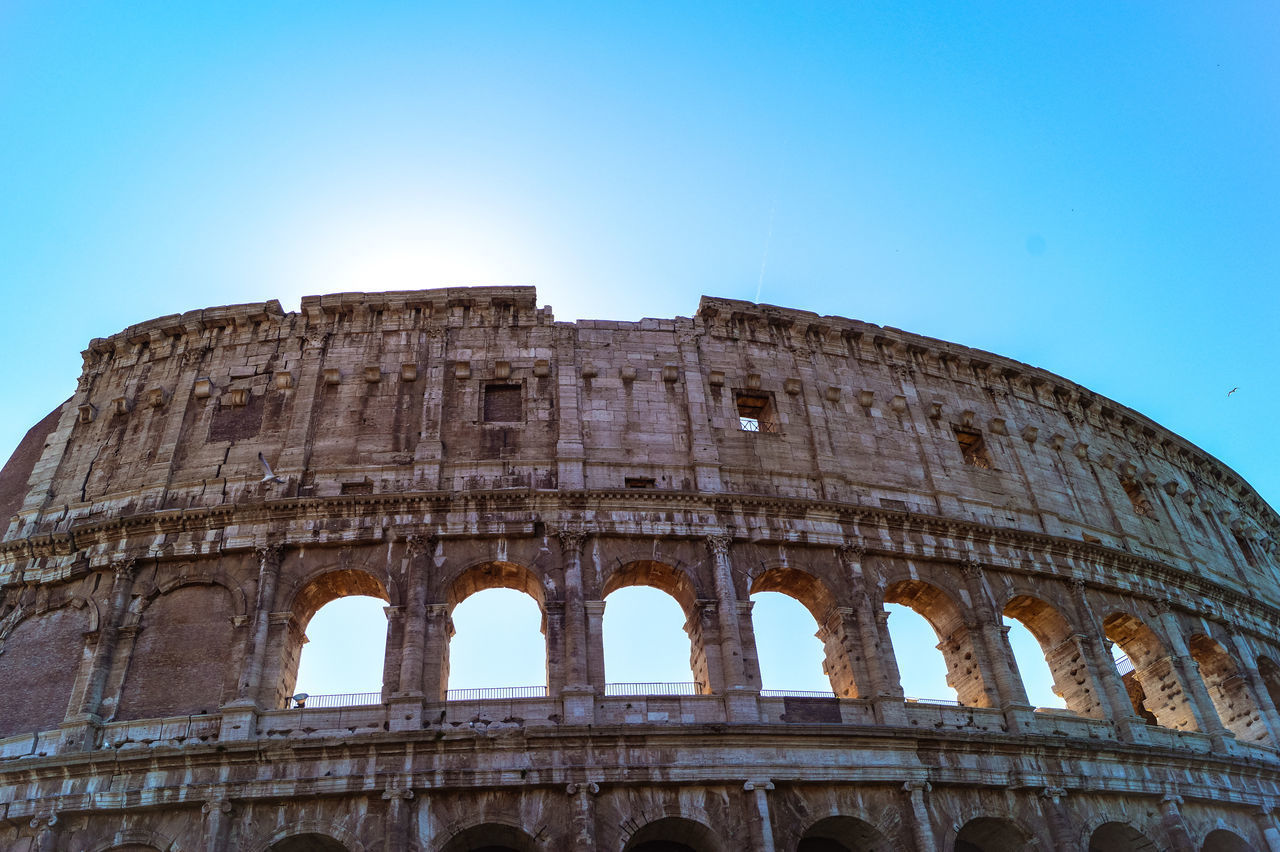 history, the past, sky, architecture, ancient, built structure, amphitheater, travel destinations, tourism, old ruin, low angle view, arch, travel, blue, clear sky, nature, ancient civilization, building exterior, no people, archaeology, ruined, ancient history