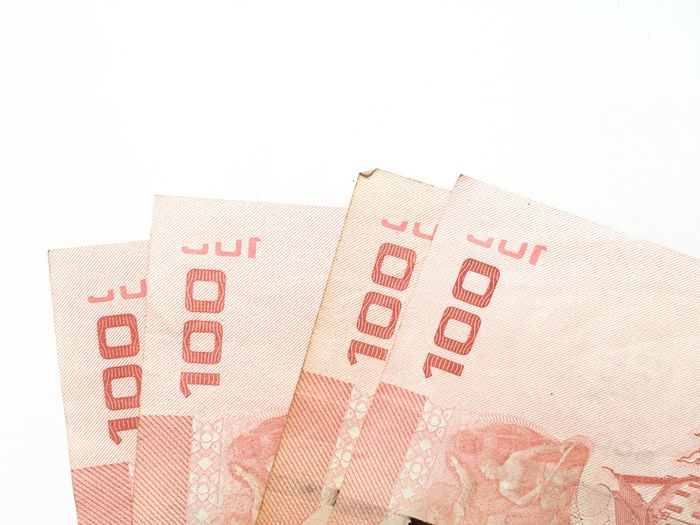 100 Baht Business Close-up Corporate Business Counting Currency Finance Financial Figures Indoors  Money No People Paper Paper Currency Red Savings Wealth White Background