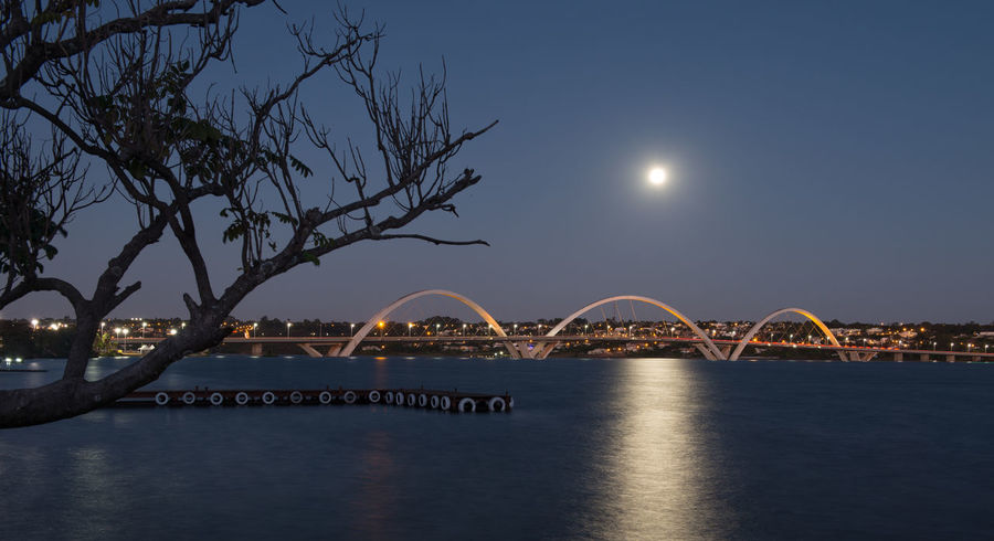 Moon over JK bridge EyeEmNewHere Brazil Brasília Skys EyeEm Selects Night Bridge - Man Made Structure Travel Destinations Sky Architecture Moon Scenics City Outdoors Cityscape Water Built Structure Landscape No People Clear Sky An Eye For Travel