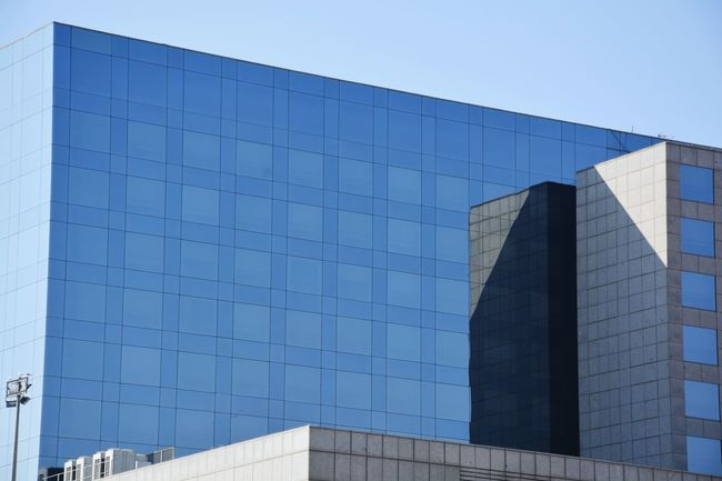 Reflection Architecture Built Structure Skyscraper Business Finance And Industry Building Exterior Clear Sky City No People Sky Outdoors Day Explore Barcelona Barcelona Architecture Reflections Reflections In The Glass Windows The City Light Minimalist Architecture EyeEmNewHere
