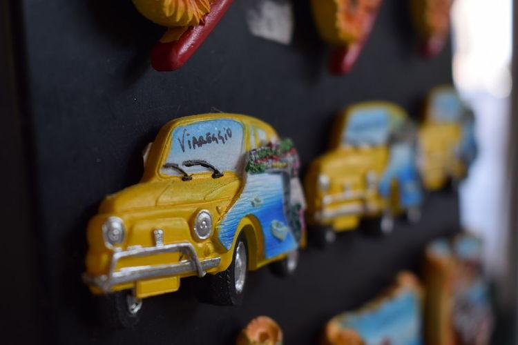 Fridge Magnets FridgeMagnets Art And Craft Car Choice Close-up For Sale Fridgemagnet Mode Of Transportation Multi Colored No People Present Selective Focus Still Life Toy Toy Car Variation Viareggio Viareggio Italy Yellow