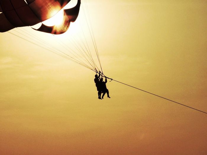 Parasailing into the sunset Silhouette Sunset Leisure Activity Paragliding Parachute Sky Adventure Holiday India Goa