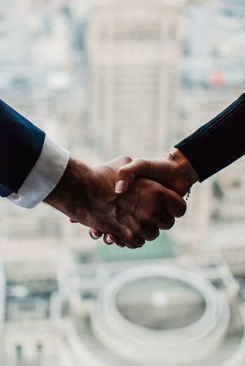 Close-up of businesspersons holding hands