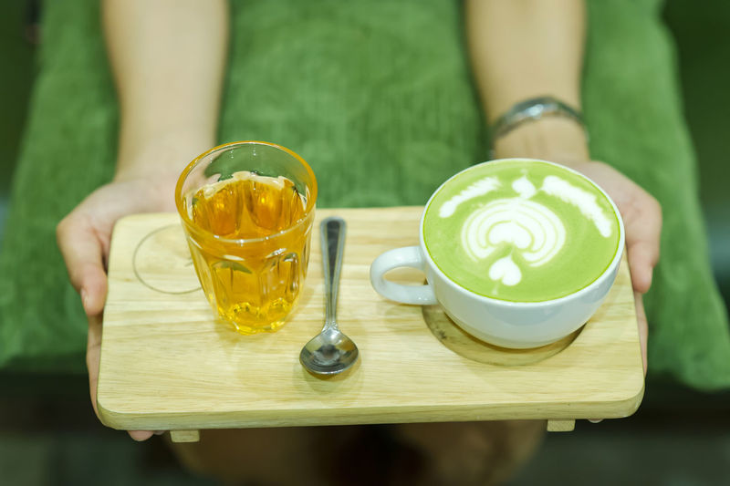 Coffee Coffee - Drink Coffee Cup Crockery Cup Drink Food Food And Drink Freshness Frothy Drink Glass Hand Holding Hot Drink Human Body Part Human Hand Latte Mug One Person Real People Refreshment Table Tray