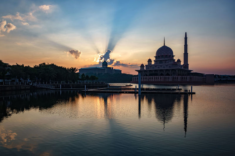 Putra Mosque By Lake Against Sky During Sunset