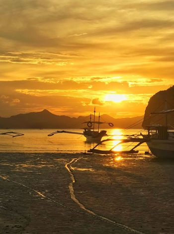 Golden moment Eyeemphotography EyeEm Gallery EyeEmNewHere Golden Hour Sunrise_sunsets_aroundworld Nature Travel Destinations Palawan El Nido Eyeem Philippines Sunset_collection EyeEm Nature Lover Eye4photography  Water Sky Sunset Sea Scenics - Nature Cloud - Sky Nautical Vessel Beauty In Nature Beach