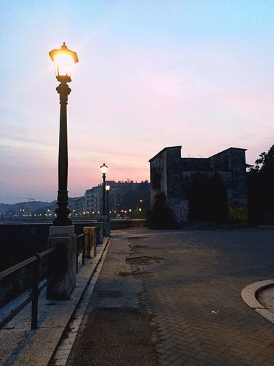 Sunset Collection By The River Snapping Randoms Finding My Color Explore The World Lovin' It Cloudy Sunset Between The Bridges Street Lamp Urban Landscape Graffiti On Walls Verona Beauties