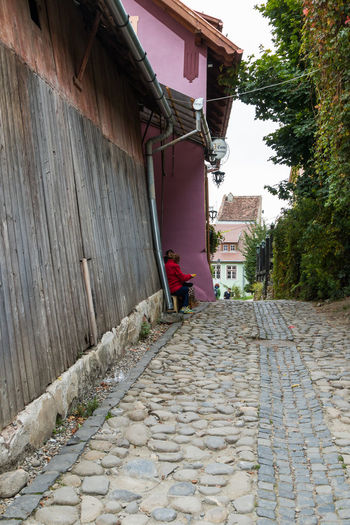 Sighisoara, Romania, October 08, 2017 : Quiet street in the castle of old city. Sighisoara city in Romania Architecture Castle Cemetery Church City Place Sighisoara-Romania Tomb Transylvania Travel Building Colorful Crypt Design Europe Famous Place Fortress Historic Landmark Medieval Old Street Tourism Tower Urban