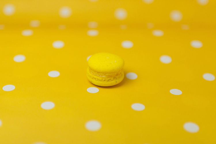 Macarons Backgrounds Close-up Colored Background Copy Space Drop Food Food And Drink Indoors  No People Pattern Still Life Studio Shot Sweet Sweet Food Yellow