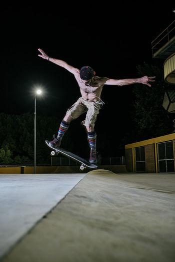 Man jumping at night