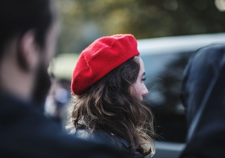 Woman wearing red hat in city