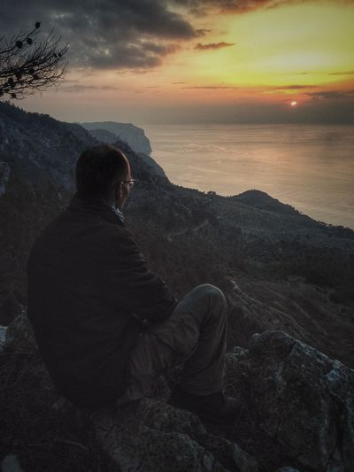 Man looks at the sunset on the coast near Estellencs, Mallorca, Spain Serra De Tramuntana Tramuntana Mallorca Travel Landscape_photography Landscape_Collection Landscape Travel Photography The Great Outdoors With Adobe Mountain View Mountain Outdoors Outdoor Photography View Viewpoint Gr221 Man One Person Sunset Looking Dreaming The Great Outdoors - 2016 EyeEm Awards Outdoor Pictures Hiking Trekking
