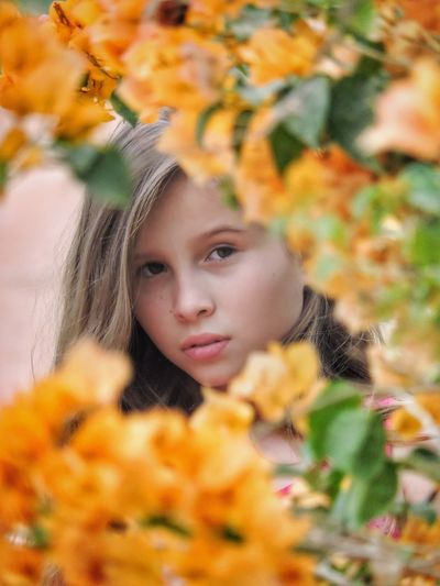Autumn Yellow Orange Color People Beauty Headshot Winter Outdoors Young Adult Close-up Warm Clothing Human Body Part Nature Human Hand Day Front View One Person Leaf Young Women Flower Nature Photography Looking At Camera