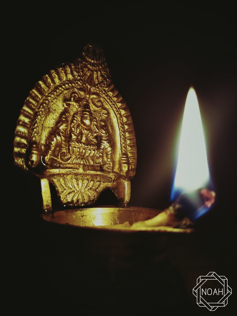 flame, burning, heat - temperature, candle, glowing, religion, spirituality, human representation, no people, illuminated, indoors, close-up, diya - oil lamp, black background, gold colored, night, oil lamp
