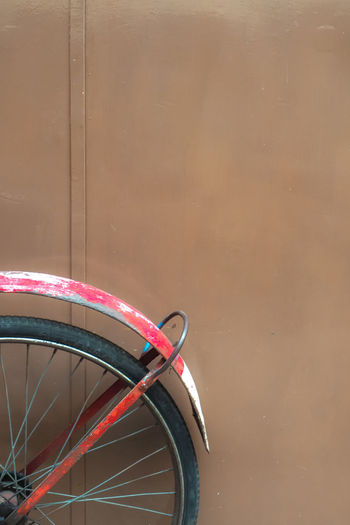 High angle view of bicycle wheel against wall