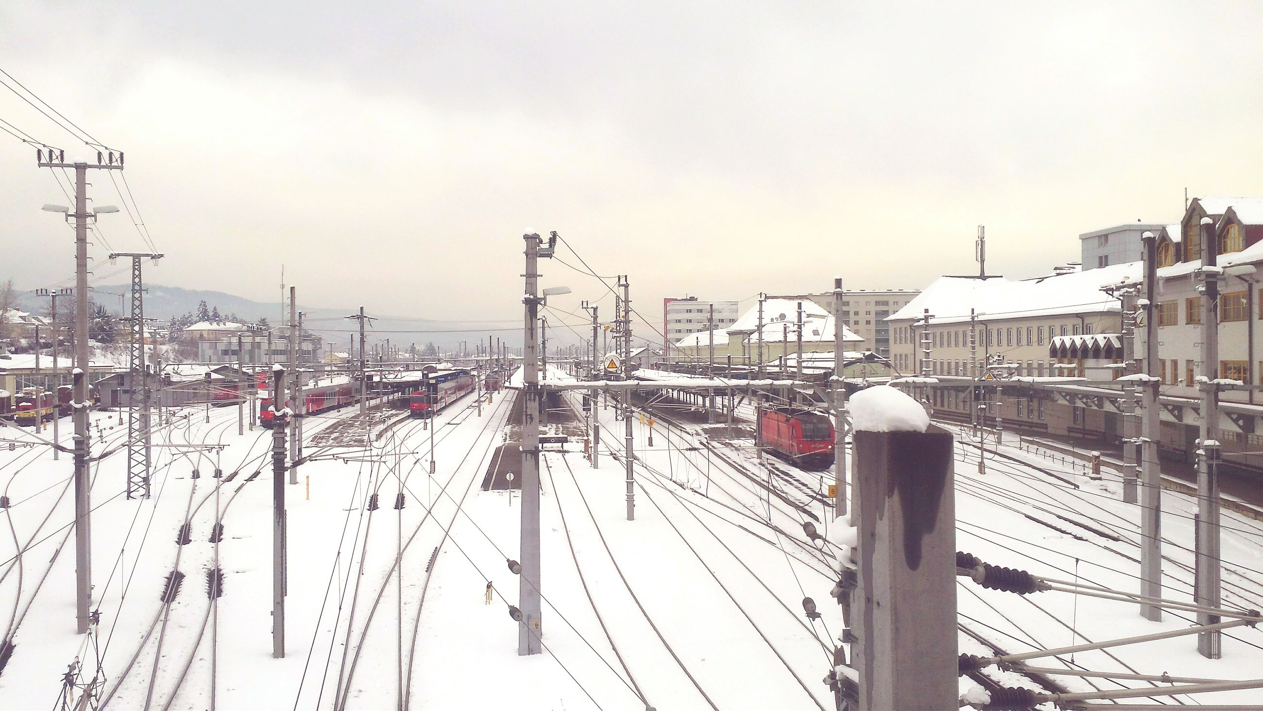 snow, winter, cold temperature, transportation, weather, connection, sky, built structure, season, bridge - man made structure, harbor, architecture, mode of transport, frozen, crane - construction machinery, outdoors, cable, day, nautical vessel, electricity pylon