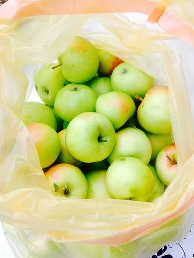 Close-Up Of Apples In Plastic Bag