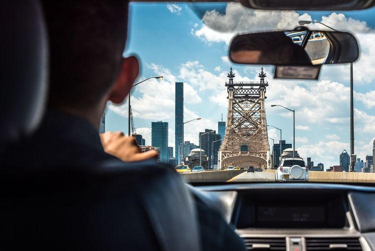 Man driving car at queensboro bridge