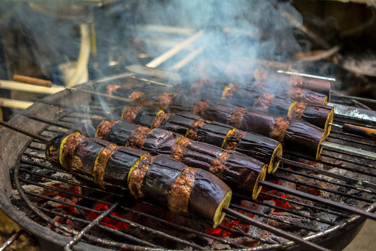 High angle view of food in skewers on barbecue grill